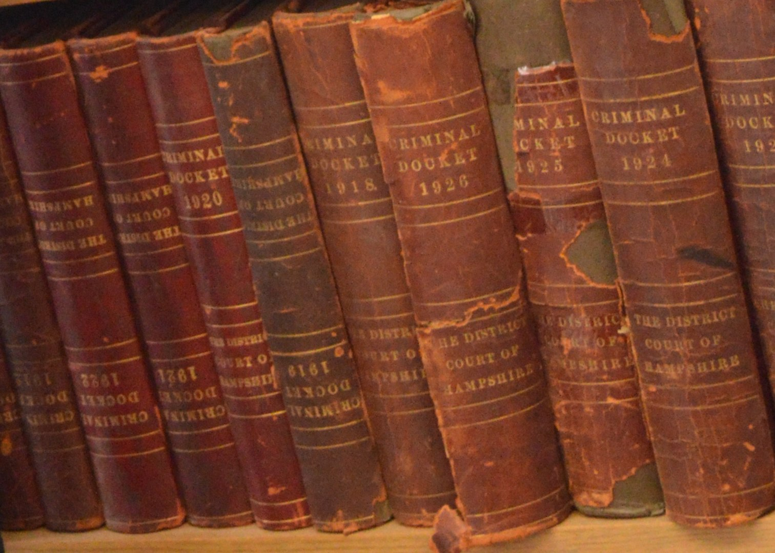 Well-used law books on a shelf