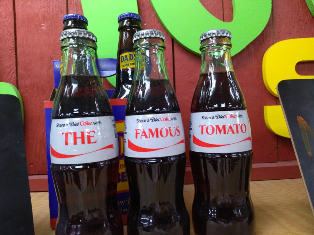 Bottle of Diet Coke spell out The Famous Tomato