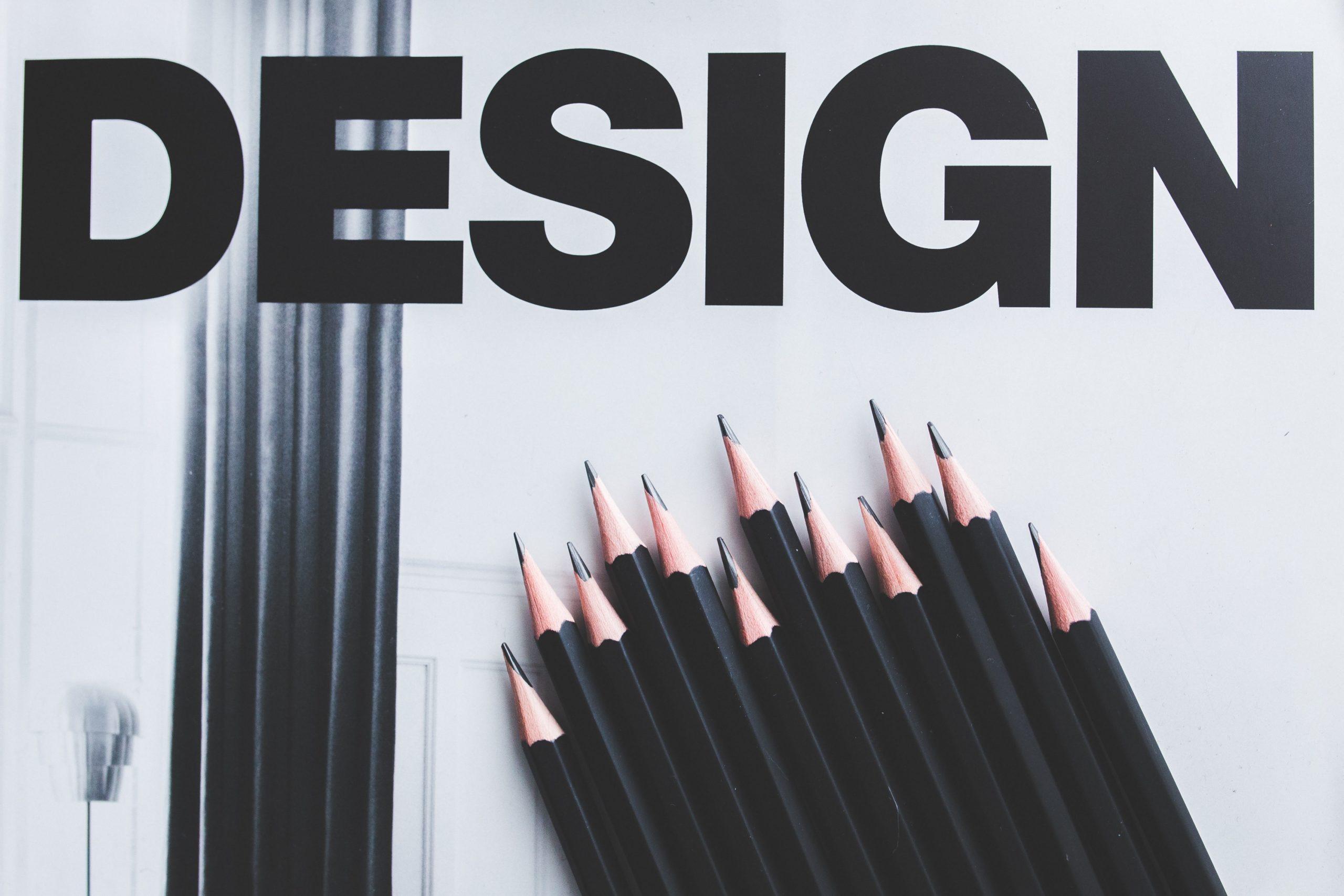Black pencils superimposed over the word DESIGN